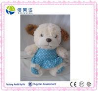 Cute plush puppy with blue spots dress