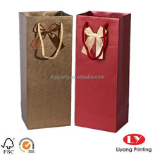 Shiny high end wine packaging paper Bag with a butterfly ribbon