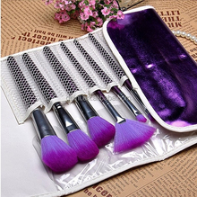 Newest cosmetic brushes in charming purple bag for face, lip and eyebrow makeup
