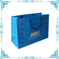 large paper bag, large shopping bag, suit carry bag
