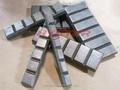 Precio competitivo de alta calidad 63 hrc de hierro blanco chockyblock, de movimiento de tierras de cangilones excavadora de piezas de desgaste, cubo de apego
