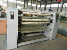 automatic tape slitting / rewinding/cutting machine with label posting function