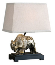Antiqued champagne finish over a textured animal desk lamp with a dark charcoal glaze and a black foot with fabric shade