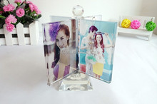 Crystal picture frame with revolving base