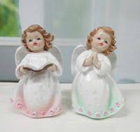 Western kissing angel figurines with book