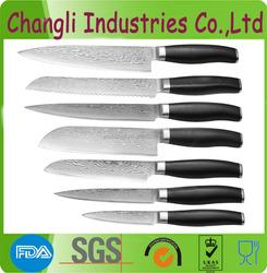 Sharp kitchen damascus knife with patterns on blade