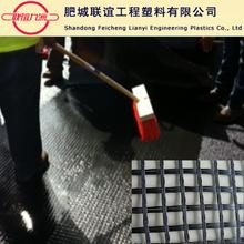 Bitumen coated fiberglass mesh geogrid for road construction