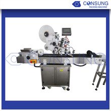 Automatic plastic bag adhesive labeling machine