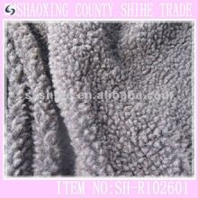 Modelo - show de imitación de piel de oveja de piel de tela de cuero