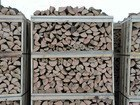 High quality dried oak firewood in the net bags.