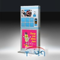 Free standing coin operated cell phone charging station with lockers