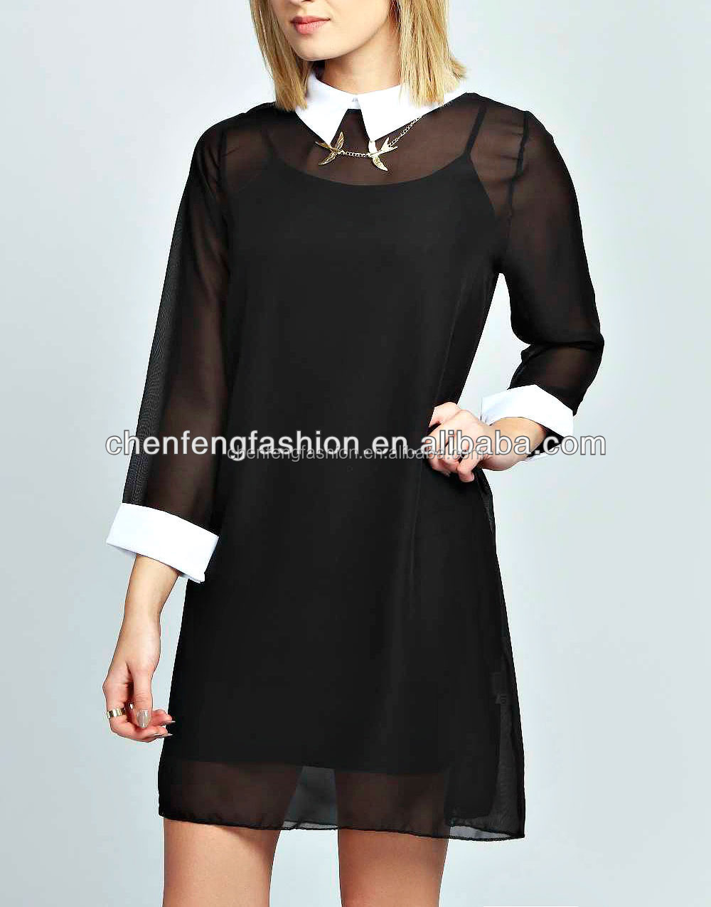 Black dress with white collar and cuffs