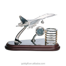 desktop airplane model with clock and pen holder