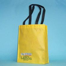 2015 custom logo print light yellow color non woven cloth shop carry packaging bag