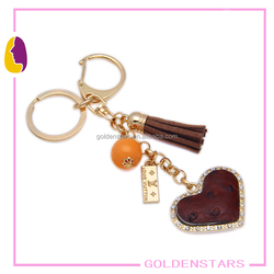 Top qualiy real leather keychains with heart leather pendant bag accessory OEM