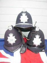 VINTAGE POLICEMANS HELMETS