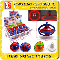 Magic Eco-friendly 10cm space Pull foot gyro plastic light up spinning top toy with music EN71