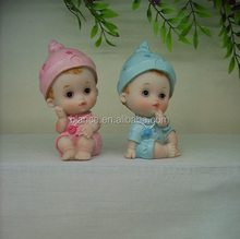 resin baby figure with hat as baby gift