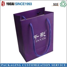 Purple paper shopping bag with logo printed