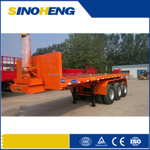 Tri-axle flatbed container transport trailer with hydraulic tipping system used for container shipping