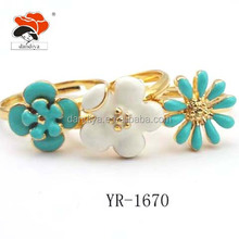 fancy selective gold enamel flower charm ring set
