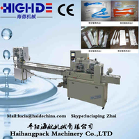 Paper roll horizontal packing wrapping machine price, spoon wet napkin paper napkin salt pepper wrapped in plastic packing mach