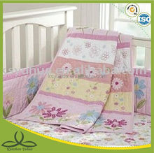 appliqued baby floral cot bumper set and quilt