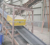 Suspended plate magnet for conveyor belt
