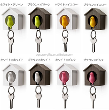 ABS plastic little bird whistle key ring in wooden house