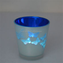 european glass candlestick with butterfly pattern
