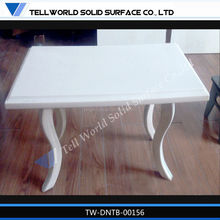 pure white composite marble top dining table with curved table leg