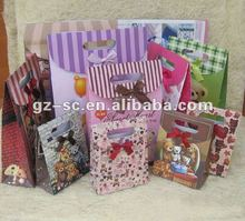 Supply paper gift bag with velcro closure