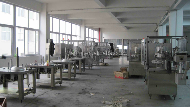 2014 hot sell pneumatic lollipop tube filling and sealing machine