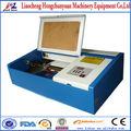 pequeño tamaño de la máquina de corte por láser/profesional precio de la máquina de corte por láser