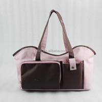 pink pet bag with pockets and adjustable shoulder strap