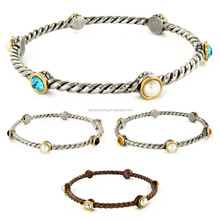Concept Two Tone Alternating Round Cut Crystal Twist Wrapped Bangle Bracelet