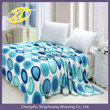 Blue circles printed coral fleece blanket in soft throw