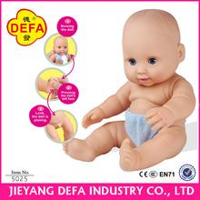 Vinyl peeing/nursing baby doll for children