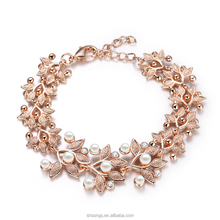 wholesale latest trends 2015 New Arrived 18K Gold Plated Artificial Pearl Women Flower bracelet hot sale bracelet designs