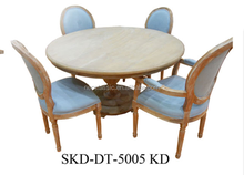 antique wooden dining table with four chairs