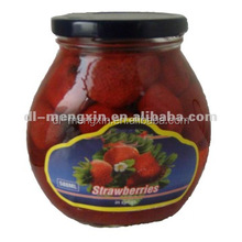 canned Strawberry fruits in light syrup in glass jar