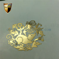 Chinese Lunar New Year paper-cut features hollow gold stickers