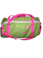 ladies round pink and green travel bags