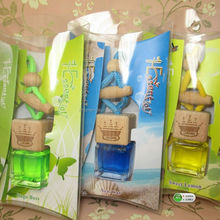 Shenzhen Lihome factory hot sell 7ml mini glass bottle hanging car perfume with logo printing on wood cap,PET box package
