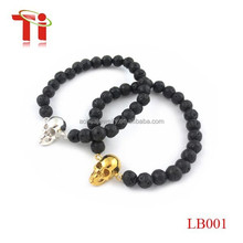 Unisex 8MM Lava stone beads with 18KGold Skull Elastic Bracelets for sale