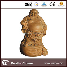brown traditional chinese brown smiling god stone carving