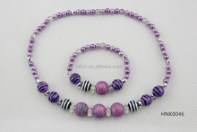 Purple imitation pearl with glitter beads necklace and bracelet sets