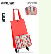 shopping trolley bag on wheels with printing on front pocket