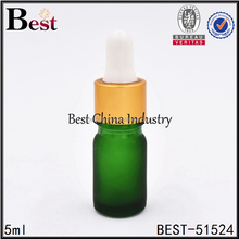 wholesale green color glass essential oil bottle for cosmetic packaging