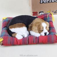 Fake and sleeping lifelike breathing dog pet
